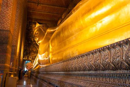 Reclining Buddha gold statue ,Wat Pho, Bangkok, Thailand photo