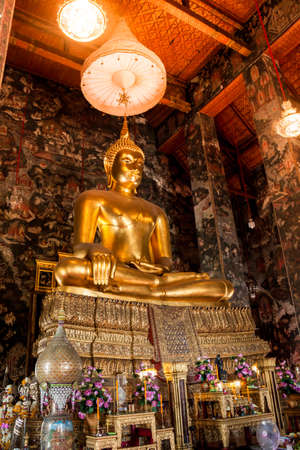 Big buddha statue beautiful in the church of the Suthat Wat at Bangkok, Thailand