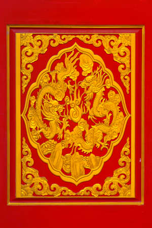 Golden dragon sculpture on ceiling at Chinese Temple, Bangkok, Thailand photo