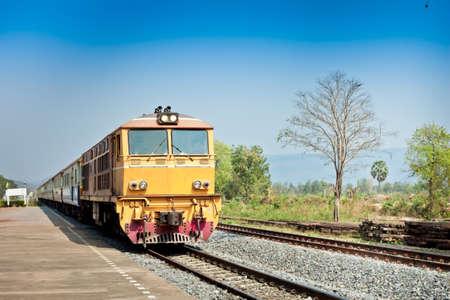 Closeup of Red orange train, Diesel locomotive, on railway station platform Thailand