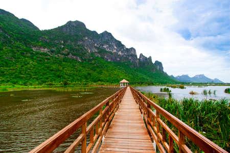 Wooden Bridge in lake under blue sky , Samroiyod national park, thailand photo
