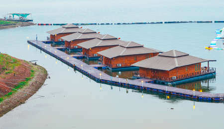 house float on water: Raft houses on Lakeside in Kanchanaburi, Thailand Stock Photo
