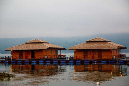 kanchanaburi: Raft houses on Lakeside in Kanchanaburi, Thailand Stock Photo
