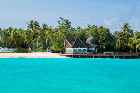 Beautiful tropical Maldives resort and island with beach and sea on blue sky for holiday vacation