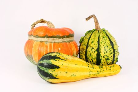 Three colorful decorative gourds, isolated photo