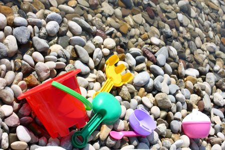 child toys on the pebble beach photo