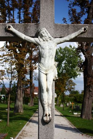Jesus Christ crucified – an old crucifix on cementery photo