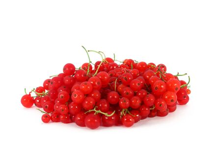 Heap of red currants, isolated on white background photo