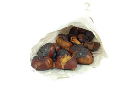 Roasted chestnuts isolated on white photo