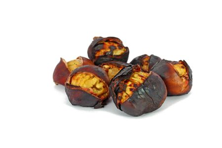 Roasted chestnuts isolated on white photo