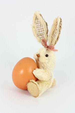Eastern rabbit made of straw and chicken egg photo