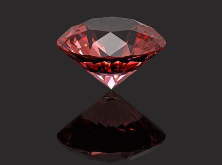 Red diamond ruby gemstone isolated on black photo