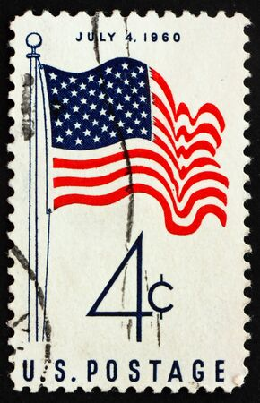 postal office: UNITED STATES OF AMERICA - CIRCA 1960: a stamp printed in the United States of America shows 50-Star US Flag July 4, circa 1960