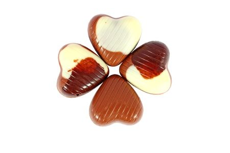 Four little chocolates ordered in form of clover photo