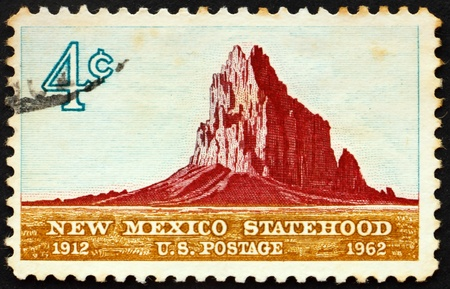 United States of America - circa 1962: a stamp printed in the United States of America shows Shiprock Mountain, New Mexico Statehood 50th anniversary, circa 1962 Stock Photo - 8599548