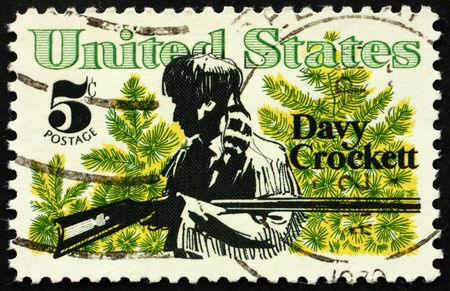 congressman: United States of America - circa 1967: a stamp printed in the United States of America shows Davy Crockett frontiersman and congressman who died in defense of the Alamo, circa 1967