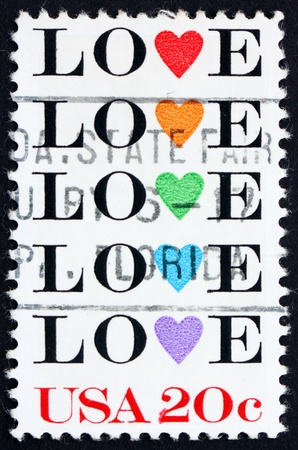 United States of America - circa 1984: a stamp printed in the United States of America shows word love with stylized hearts, circa 1984 photo