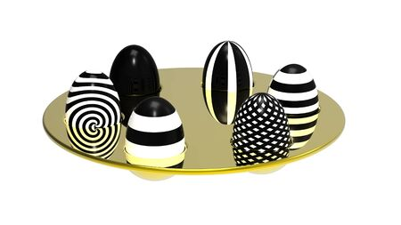 Black and white eggs on golden plate photo