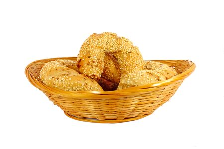 smal: Smal rolls in a little woven basket isolated on white