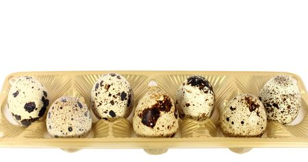 japanese quail: Eggs of japanese quail in little basket isolated on white Stock Photo