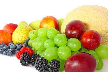 Mix of juicy fruit  isolated on white photo