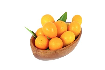 midget: kumquat midget orange in wooden bowl isolated on white Stock Photo