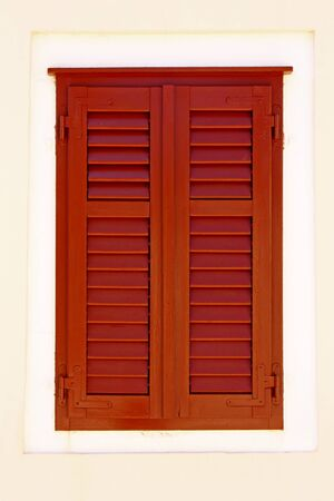 security shutters: closed brown wooden window shutters, security element Stock Photo
