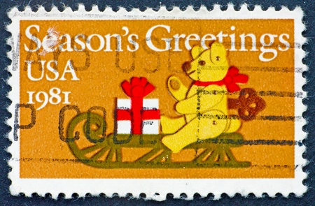 UNITED STATES OF AMERICA - CIRCA 1981: a stamp printed in the United States of America shows  Felt Bear on Sled, circa 1981 photo