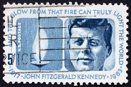 UNITED STATES OF AMERICA - CIRCA 1964: a stamp printed in the United States of America shows President John F. Kennedy and Eternal Flame, circa 1964
