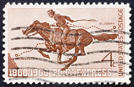 postal office: UNITED STATES OF AMERICA - CIRCA 1960: a stamp printed in the United States of America shows Pony Express Rider, circa 1960