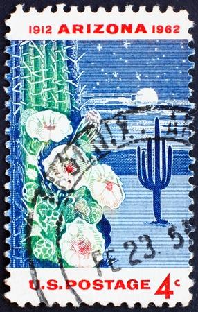 UNITED STATES OF AMERICA - CIRCA 1962: a stamp printed in the United States of America shows Giant Saguaro Cactus, Arizona Statehood, circa 1962 photo