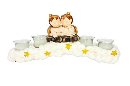 Christmas candle Holder with two little angel isolated photo