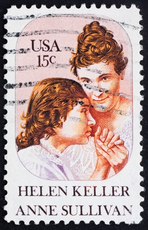 helen: UNITED STATES OF AMERICA - CIRCA 1980: a stamp printed in the United States of America shows Helen Keller and Anne Sullivan, circa 1980