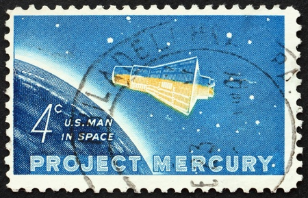UNITED STATES OF AMERICA - CIRCA 1962: a stamp printed in the United States of America shows Project Mercury, Friendship 7 capsule and Globe, circa 1962 Stock Photo - 10300811