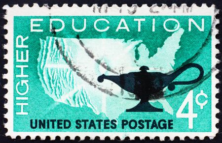 UNITED STATES OF AMERICA - CIRCA 1962: a stamp printed in the United States of America shows Map of U.S. and Lamp, higher education, circa 1962 photo