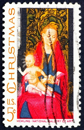 memling: UNITED STATES OF AMERICA - CIRCA 1966: a stamp printed in the United States of America shows picture of Madonna and Child with Angels by Flemish artist Hans Memling, circa 1966