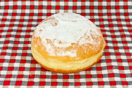 dishtowel: Doughnut sprinkled with sugar on dishtowel with a checkered pattern