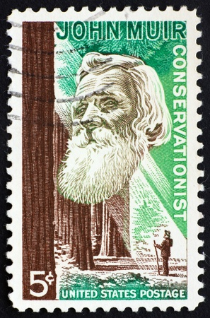 conservationist: UNITED STATES OF AMERICA - CIRCA 1964: a stamp printed in the United States of America shows John Muir, American naturalist and conservationist, circa 1964 Stock Photo