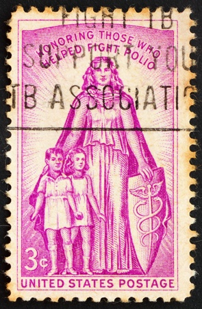 polio: UNITED STATES OF AMERICA - CIRCA 1957: a stamp printed in the United States of America shows Allegory with inscription Honoring those who helped fight polio, circa 1957