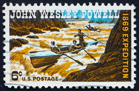 wesley: UNITED STATES OF AMERICA - CIRCA 1969: a stamp printed in the United States of America shows John Wesley Powell Exploring Colorado River, circa 1969 Stock Photo