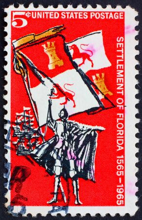 UNITED STATES OF AMERICA - CIRCA 1965: a stamp printed in the United States of America shows Spanish Explorer, Royal Flag and Ships, 400th anniversary of the first permanent European settlement in the continental U.S. St. Augustine, Florida, circa 1965 photo
