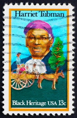 abolitionist: UNITED STATES OF AMERICA - CIRCA 1978: a stamp printed in the United States of America shows Harriet Tubman and Cart Carrying Slaves, circa 1978 Stock Photo