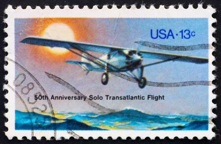 charles: UNITED STATES OF AMERICA - CIRCA 1977: a stamp printed in the United States of America shows plane, Spirit of St. Louis, 50 anniversary of 1st solo transatlantic flight from NY to Paris, circa 1977