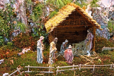 Christmas nativity scene of jesus birth in an old cottage photo