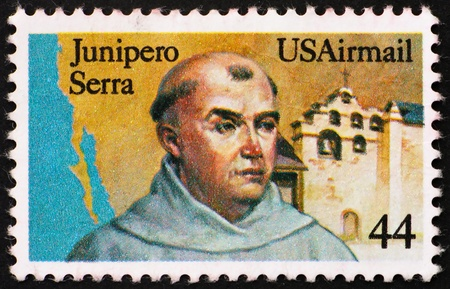 UNITED STATES OF AMERICA - CIRCA 1985: a stamp printed in the United States of America shows Fr. Junipero Serra, California Missionary and San Gabriel Mission, California, circa 1985 photo