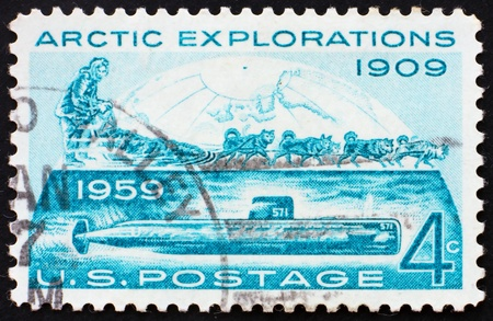 robert: UNITED STATES OF AMERICA - CIRCA 1959: a stamp printed in the United States of America shows Conquest of the Arctic by Land by Rear Admiral Robert Edwin Peary in 1909 and by sea by the submarine Nautilus in 1958, circa 1959