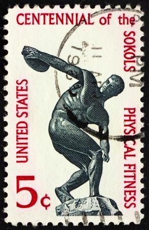 centenary: UNITED STATES OF AMERICA - CIRCA 1965: a stamp printed in the United States of America shows Discus thrower, centenary of founding Sokol, athletic organization in America, circa 1965 Stock Photo