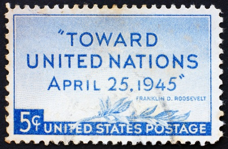 united nations: UNITED STATES OF AMERICA - CIRCA 1945: a stamp printed in the United States of America shows olive branch and inscription Toward United Nations April 25,1945, United Nations Conference San Francisco, circa 1945 Stock Photo
