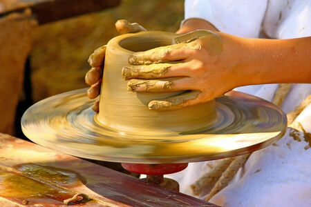 potters wheel: Making the pot on the potters wheel, closeup