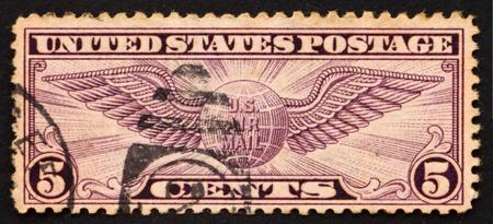UNITED STATES OF AMERICA - CIRCA 1930: a stamp printed in the United States of America shows Winged globe, circa 1930 photo